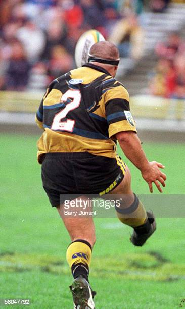 Hurricanes hooker Norm Hewitt chips the ball infield for Tana Umaga to score during the Blues 4534 win in the Super12 clash at Athletic Park...