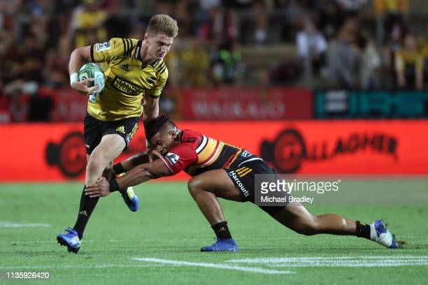 Hurricanes Jordie Barrett makes a break during the round five Super Rugby match between the Chiefs and the Hurricanes at FMG Stadium on March 15 2019...