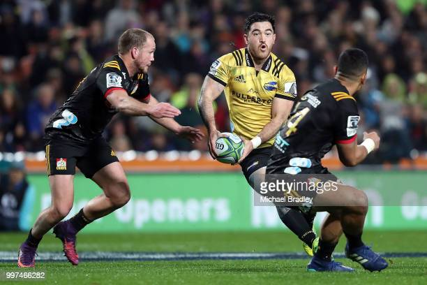 Hurricanes' Nehe MilnerSkudder looks of a gap in the defence during the round 19 Super Rugby match between the Chiefs and the Hurricanes at Waikato...