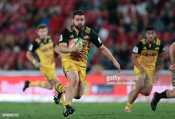 Hurricanes' New Zealand Captain and hooker Dane Coles breaks through during the Super Rugby clash between Lions and Hurricanes at Ellis Park rugby...