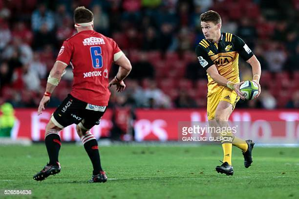 Hurricanes' New Zealand first fiveeight Beauden Barrett gets ready to clear the ball during the Super Rugby clash between Lions and Hurricanes at...