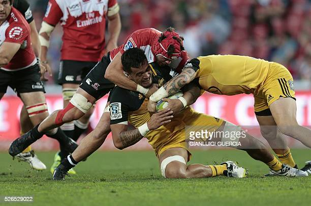 Hurricanes' New Zealand loose forward Vaea Fifita is tackled during the Super Rugby clash between Lions and Hurricanes at Ellis Park rugby stadium on...