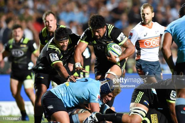 Hurricanes player Ardie Savea runs over Waratahs player Ned Hanigan at The Super Rugby game between NSW Waratahs and Hurricanes on February 16 2019...