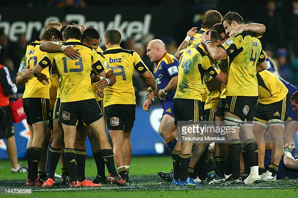 Hurricanes players celebrate after the round 12 Super Rugby match between the Highlanders and the Hurricanes at Forsyth Barr Stadium on May 12 2012...