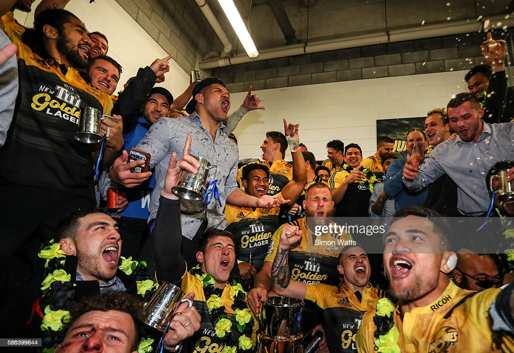 Hurricanes players celebrate in the changing room after winning the 2016 Super Rugby Final match between the Hurricanes and the Lions at Westpac Stadium on August 6, 2016 in Wellington, New Zealand.