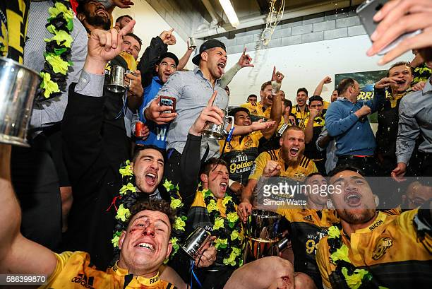 Hurricanes players celebrate in the changing room after winning the 2016 Super Rugby Final match between the Hurricanes and the Lions at Westpac...