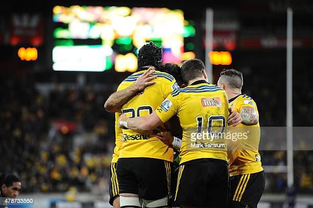 Hurricanes players celebrate Matt Proctor's try during the Super Rugby Semi Final match between the Hurricanes and the Brumbies at Westpac Stadium on...