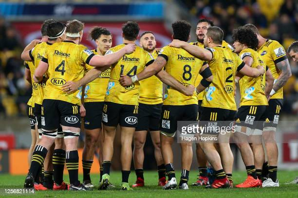 Hurricanes players form a huddle during the round 6 Super Rugby Aotearoa match between the Hurricanes and the Blues at Sky Stadium on July 18, 2020...