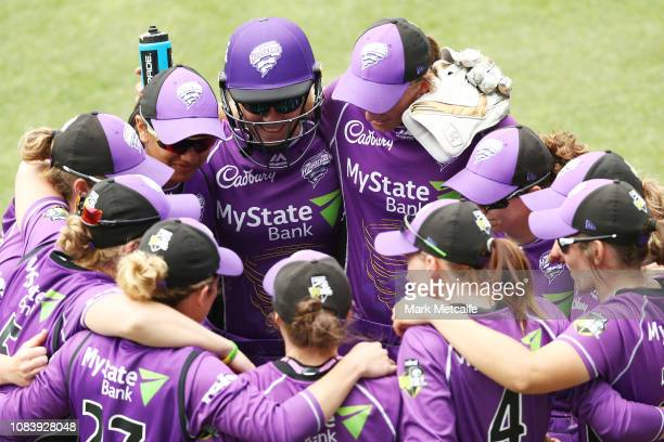 Hurricanes players huddle during the Women's Big Bash League match between the Hobart Hurricanes and the Perth Scorchers at Blundstone Arena on...