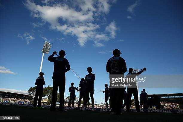 Hurricanes players stretch before the Big Bash League match between the Hobart Hurricanes and Sydney Stars at Blundstone Arena on December 26 2016 in...
