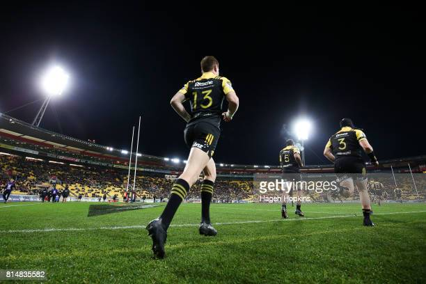 Hurricanes players take the field during the round 17 Super Rugby match between the Hurricanes and the Crusaders at Westpac Stadium on July 15 2017...