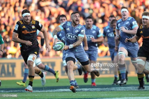 Hurricanes TJ Perenara makes a break during the round seven Super Rugby match between the Chiefs and the Hurricanes at Waikato Stadium on March 13...