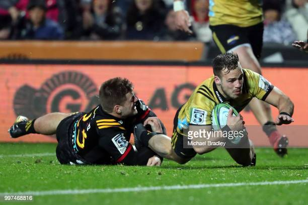 Hurricanes' Wes Goosen dives in for a tryduring the round 19 Super Rugby match between the Chiefs and the Hurricanes at Waikato Stadium on July 13...