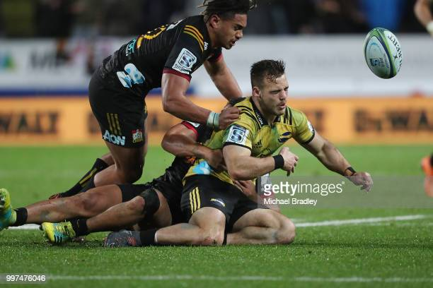 Hurricanes' Wes Goosen is tackled by Chiefs Johnny FaÕauli who was red carrded for this tackle and Anton LienertBrown during the round 19 Super Rugby...
