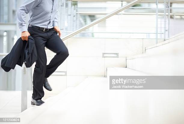 Hurry - Business man climbing up the stairs