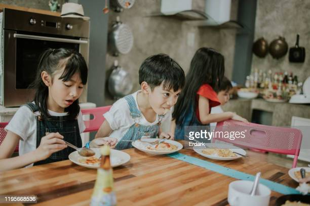 hurry of thai children eating school dinners stock photo - sports round stock pictures, royalty-free photos & images