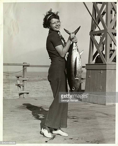 'Hurry up He's heavy take that picture quick' Miss Hermine Sierks a Pasadena society girl finds posing for a picture with her Albacore catch made at...