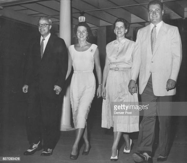 Hurrying from the Orchard Cafe where they had dined before the opening curtain of 'Sobrina Fair' Monday night at Elitch Theater were Mr and Mrs John...