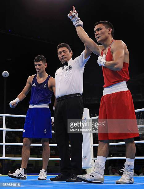 Hurshid Tojibaev of Uzbekistan celebrates beating Joseph Cordina of Great Brittain in their Mens Lightweight 60kg bout on Day 4 of the Rio 2016...