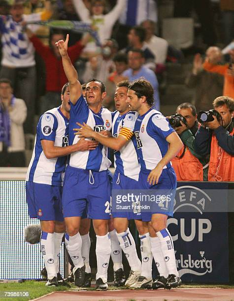 Hurtado Moises of Espanyol celebrates his goal during the UEFA Cup semi final first leg match between with Daniel Jarque and Raul Tamudo of Espanyol...
