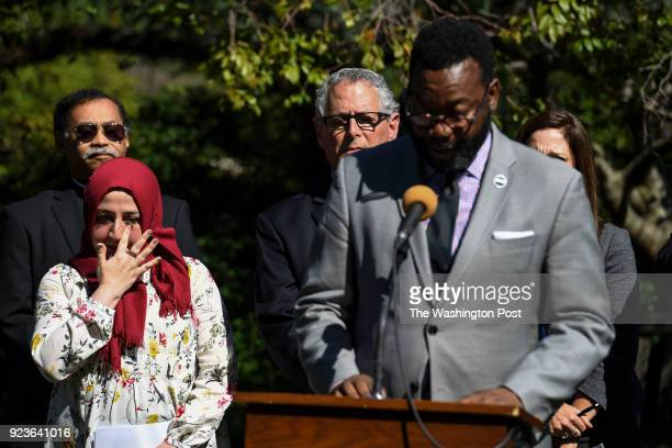 Hurunnessa Fariad interfaith coordinator for the All Dulles Area Muslim Society wipes away a tear as Rev Thomas Bowen director of the DC Mayor's...