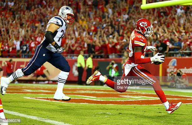 Husain Abdullah of the Kansas City Chiefs scores a touchdown after an interception against the New England Patriots at Arrowhead Stadium on September...