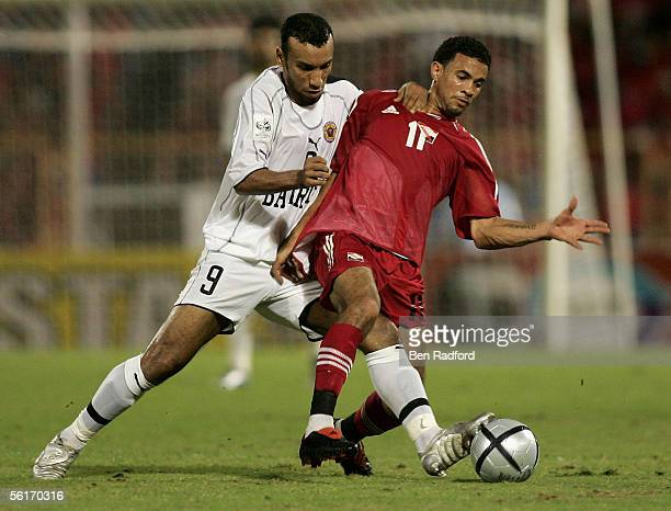 Husain Ali Ahmed of Bahrain battles with Carlos Edwards of Trinidad during the FIFA World Cup Playoff, 1st Leg match between Trinidad and Tobago and...