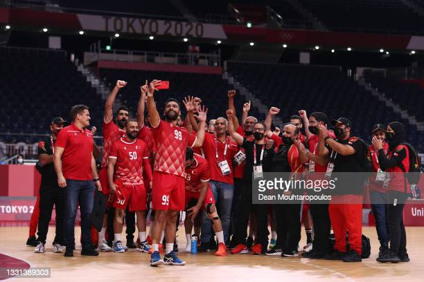 Husain Alsayyad of Team Bahrain takes a selfie with his teammates and staff after winning the Men's Preliminary Round Group B handball match between...