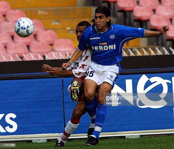 Husain of Napoli and Ze Maria of Perugia in action during the Serie A 23rd Round League match between Napoli and Perugia played at the San Paolo...