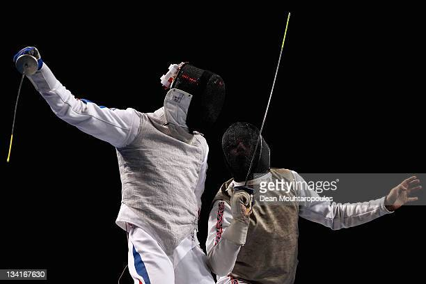 Husayn Rosowsky of Great Britain in action against Brice Guyart of France during the Men's Foil Team Bronze Medal match at the Fencing Invitational...