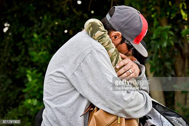 Husband Adam Romero left and wife Michelle Romero right embrace after being reunited on San Bernardino Ave Thursday afternoon Michelle Romero had...