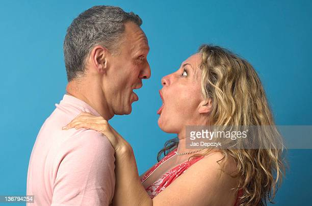 husband an wife communicating surprise - depczyk stock pictures, royalty-free photos & images