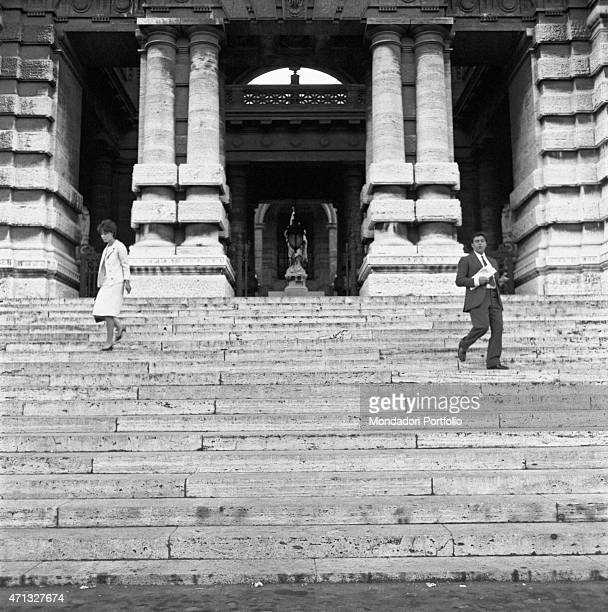 A husband and a wife decided to divorce and they go down the staircase of the palazzo di Giustizia far from each other Rome 1970s