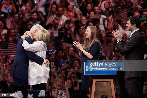 Husband and former president Bill Clinton hugs Democratic presidential candidate Hillary Clinton as daughter Chelsea Clinton and Marc Mezvinsky look...