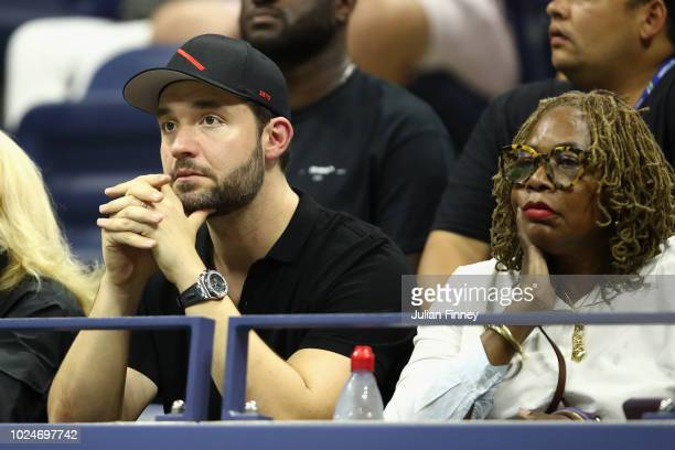 Husband and mother of Serena Williams Alexis Ohanian Oracene Price watch the women's singles first round match between Serena Williams and Magda...