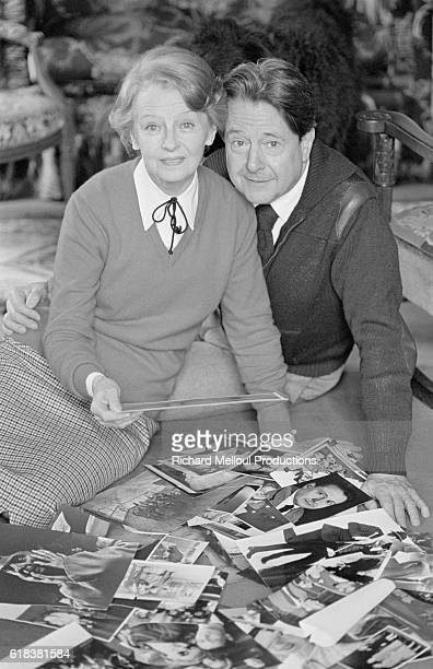 Husband and wife actors Jean Desailly and Simone Valere look at old photographs The two have starred together in both film and theater
