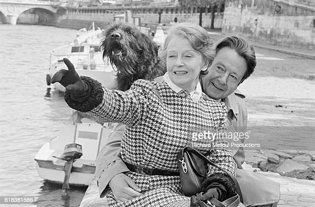 Husband and wife actors Jean Desailly and Simone Valere sit along the Seine river in Paris. The two have starred together in both film and theater.