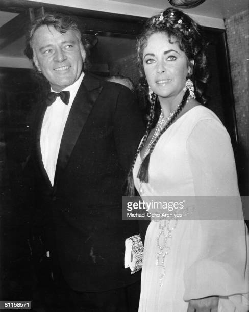 Husband and wife actors Richard Burton and Elizabeth Taylor attend an event in circa 1970