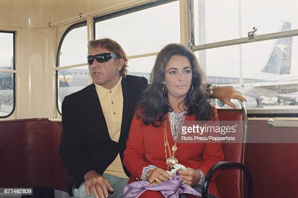 Husband and wife actors Richard Burton and Elizabeth Taylor pictured sitting together on an airport transit bus after arriving at London's Heathrow...