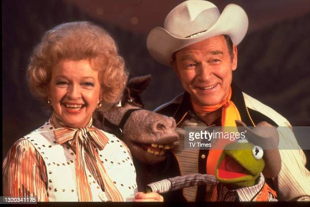 Husband and wife actors Roy Rogers and Dale Evans with puppet character Kermit The Frog on the set of The Muppet Show at Elstree Studios,...