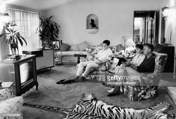 Husband and wife actors Stewart Granger and Jean Simmons watch TV with their son Jamie Granger at Yerba Buena Ranch California in 1959