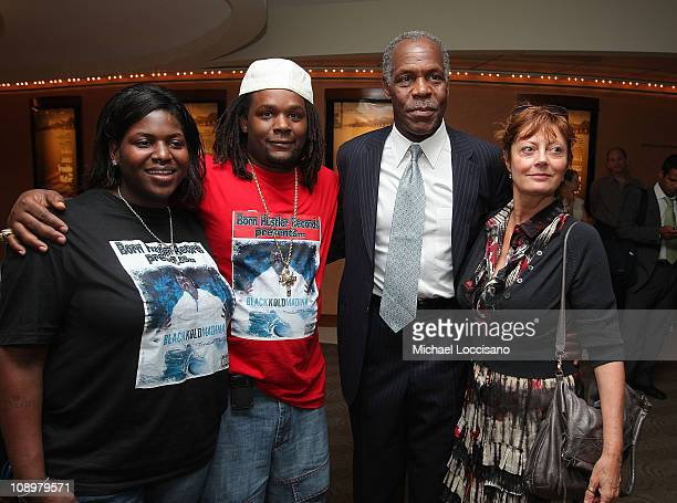 Husband and wife and film subjects Kimberly Rivers Roberts and Scott Roberts coproducer and actor Danny Glover and actress Susan Sarandon attend the...