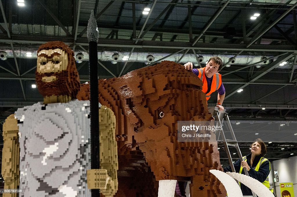 Husband and wife Annie Diment and Ed Diment, put the final bricks in place on their Ice Age display, with a Lego wolly mammouth made from 400,000 bricks which took 9 weeks to build at ExCel on December 10, 2015 in London, England. Brick 2015 is an exhibition dedicated to Lego and runs at London's ExCel over three days starting on 11th December. It features displays including Harry Potter, landmarks such as Big Ben and a dance music festival.