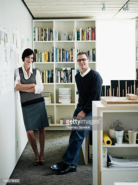 Husband and wife architect team in office portrait