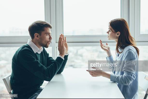 husband and wife argue with each other during a conflict. - conflittualità foto e immagini stock