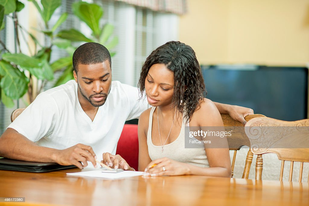 Husband and Wife Balancing Their Budget : Stock Photo