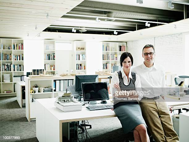Husband and wife business owners in office