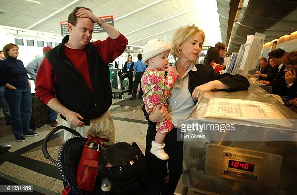 Husband and wife Cole Kimball and Laura Love and their daughter Kirby all head for their flights at DIA Laura is on a busines trip to Florida Cole...