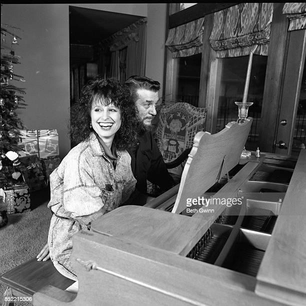 Husband and wife country singers and songwriters Waylon Jennings and Jessi Colter in their living room on December 9 1987 in Nashville Tennessee