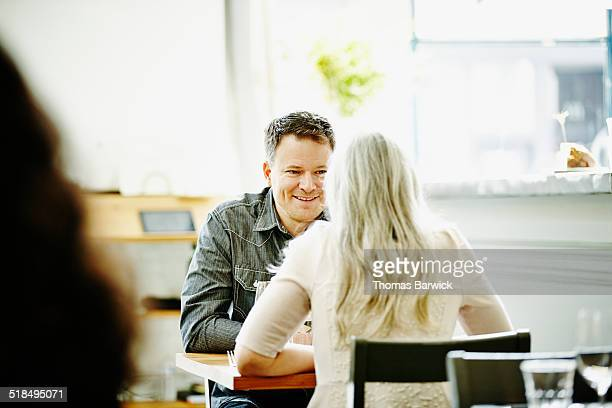 Husband and wife dining together in restaurant